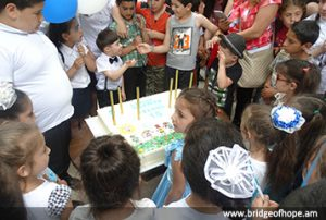Children with celebration cake